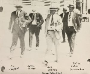 Al Capone walking along Dade County Courthouse in 1930