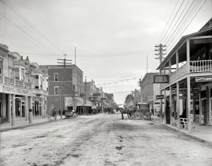 Twelfth Street in 1908. Commercial Hotel & Schmids Restaurant on right.