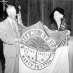 Jane Fisher and J.N. Lummus with Miami Beach city flag.