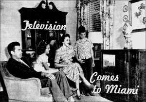 Family around TV set in 1949